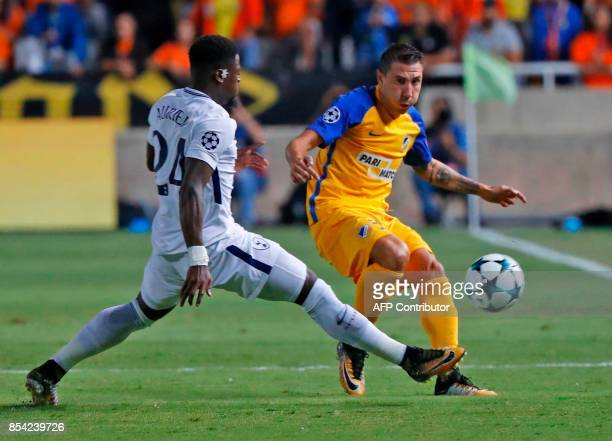 Apoel FC's Spanish defender Roberto Lago vies for the ball against Tottenham Hotspur's French defender Serge Aurier during the UEFA Champions League...