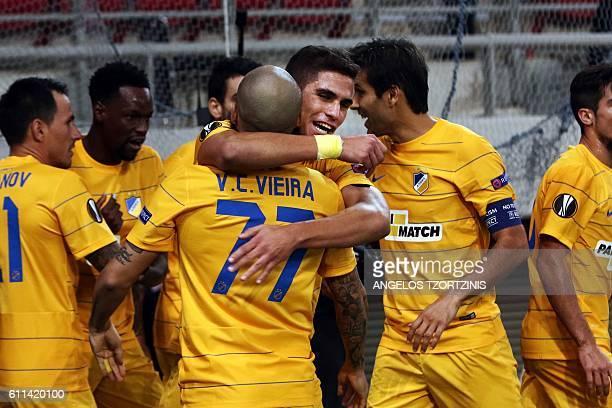 Apoel Nicosia' Cypriot Pieros Sotiriou celebrates with teammates after scoring his team's first goal during the UEFA Europa League group football...