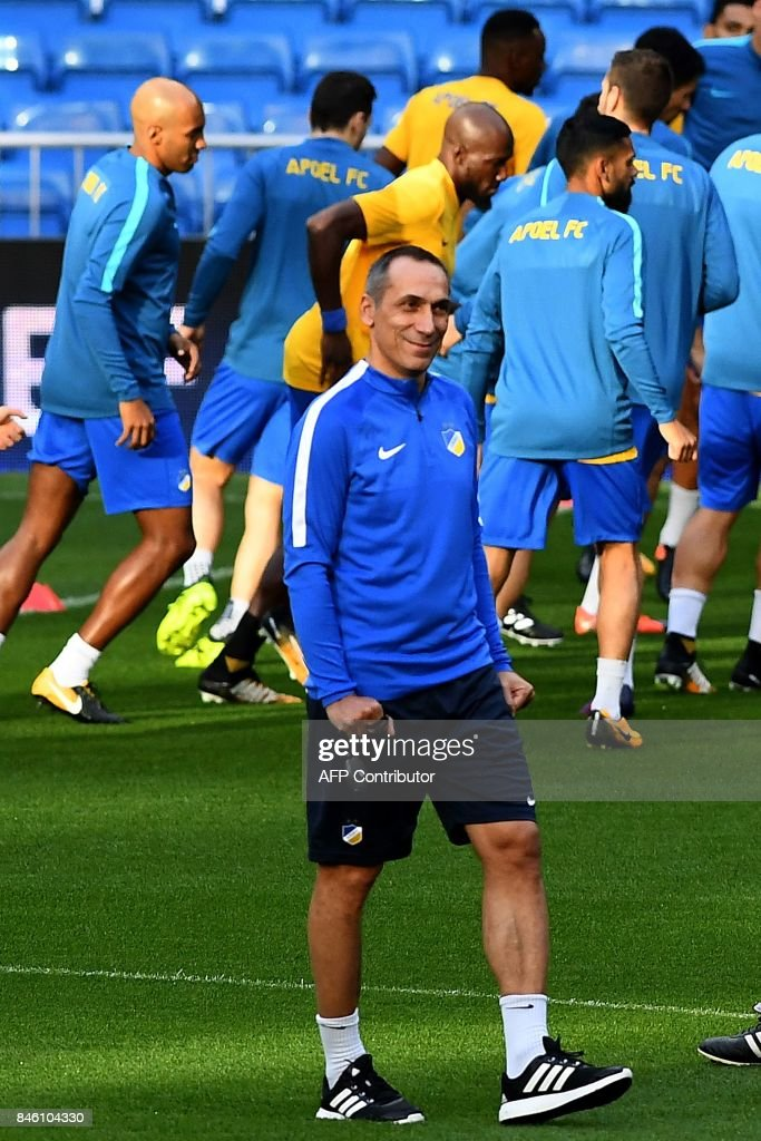 Apoel's coach from Greece Giorgos Donis walks on the pitch during a training session at the Santiago Bernabeu stadium in Madrid on September 12, 2017 on the eve of the UEFA Champions League football match Real Madrid CF vs Apoel FC. /