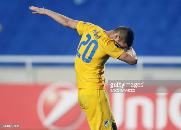 TOPSHOT Apoel's Cypriot striker Pieros Sotiriou celebrates his goal and his team's opening goal during the Europa League football match between APOEL...