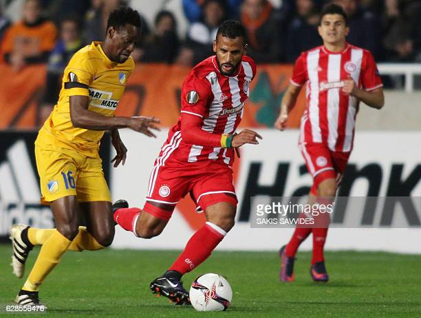 Apoel's midfielder Vinicius is marked by Olympiacos' midfielder Alaixys Romao during the Europa League Group B football match between Cyprus' APOEL...