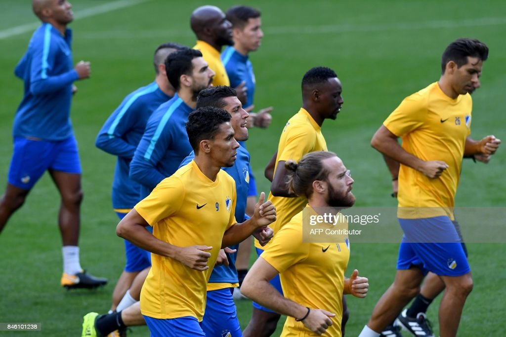 Apoel's players jog during a training session at the Santiago Bernabeu stadium in Madrid on September 12, 2017 on the eve of the UEFA Champions League football match Real Madrid CF vs Apoel FC. /