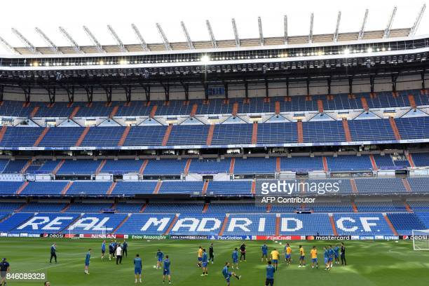 Apoel's players warm up on the pitch during a training session at the Santiago Bernabeu stadium in Madrid on September 12 2017 on the eve of the UEFA...