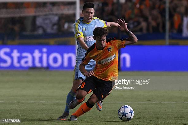 Apoel's Tomas De Vincenti and FC Astana's Georgy Zhukov in action during UEFA Champions League play off between APOEL Nicosia and FC Astana at GSP...