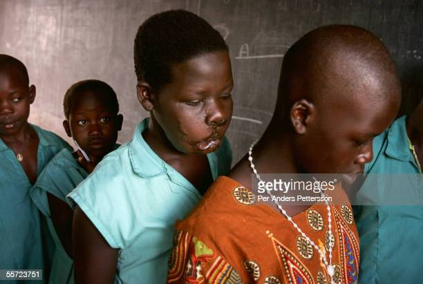 Apoko Evelyn age 14 waits with her class mates to see her teacher at the St Mary Immaculate primary school on May 28 2005 outside Gulu in Northern...
