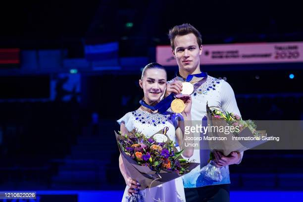 Apollinariia Panfilova and Dmitry Rylov of Russia pose in the Junior Pairs medal ceremony during day 2 of the ISU World Junior Figure Skating...