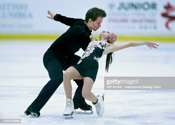 Apollinarilia Panfilova and Dmitry Rylov of Russia skate in the junior pairs short program during the 2018 Junior Grand Prix of Figure Skating on...