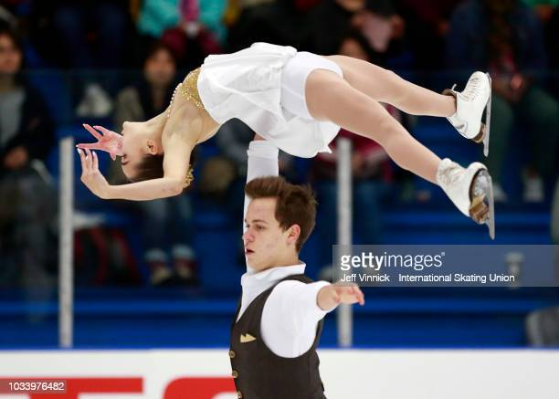 Apollinarlia Panfilova and Dmitry Rylov of Russia perform during their silver medal junior pairs final skate during the 2018 Junior Grand Prix of...