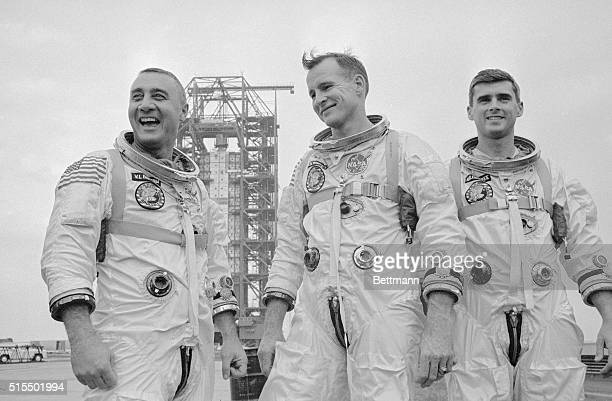 Apollo 1 astronauts Virgil Gus Grissom Edward White and Roger Chaffee suited up and visiting the Saturn launch pad A few days later all three would...