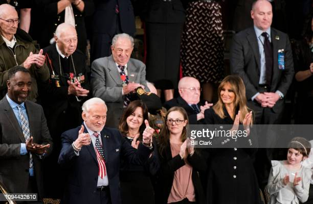 Apollo 11 astronaut Buzz Aldrin left gives a thumbs up as First Lady Melania Trump claps after he is introduced during President Donald Trump's State...