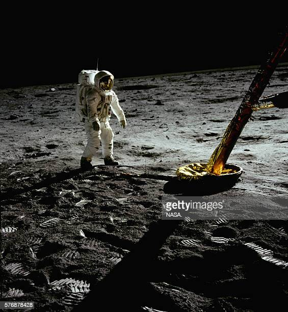 Apollo 11 astronaut Buzz Aldrin walks near one of the legs of the Eagle lander at Tranquility Base on the moon's surface