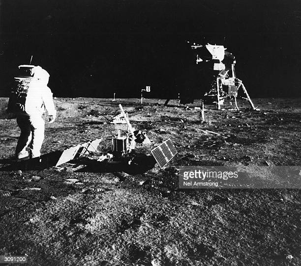 Apollo 11 astronaut Edwin 'Buzz' Aldrin deploys a scientific experiment package on the surface of the moon In the background is the Lunar Module as...