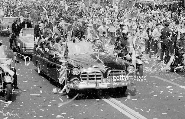 Apollo 11 astronauts Buzz Aldrin Michael Collins and Neil Armstrong are showered with confetti and warmed by the cheers of enthusiastic throngs that...