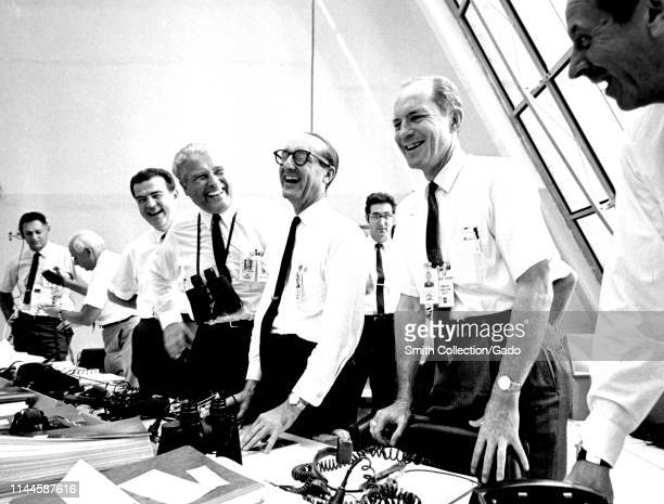 Apollo 11 mission officials relaxing in the Launch Control Center at Kennedy Space Center on Merritt Island Florida including Charles W Mathews Dr...