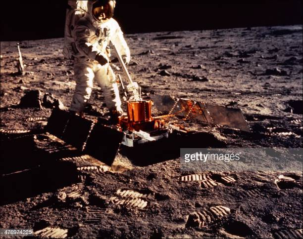Apollo 11 space mission US astronaut Buzz Aldrin is seen conducting experiments with the Passive Experiment Package on the moon's surface on a...