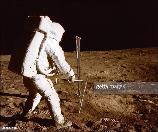 Apollo 11 space mission US astronaut Buzz Aldrin is seen conducting experiments on the moon's surface on a picture taken by Neil Armstrong after both...