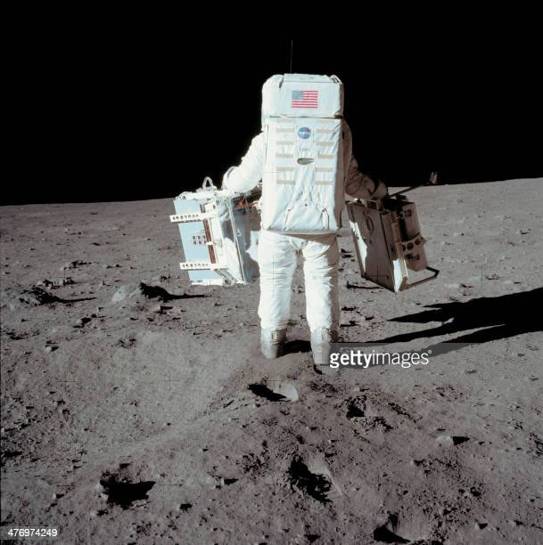 Apollo 11 space mission US astronaut Buzz Aldrin is seen conducting experiment on the moon's surface on a picture taken by Neil Armstrong a while...