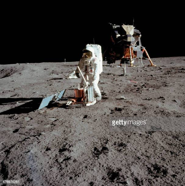 Apollo 11 space mission US astronaut Buzz Aldrin is seen conducting experiments on the moon's surface in a picture taken by Neil Armstrong after both...