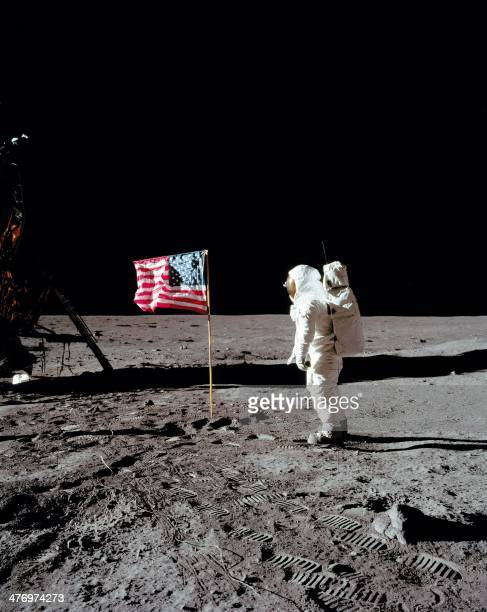 Apollo 11 space mission US astronaut Buzz Aldrin salutes the US flag on the moon's surface in a picture taken by Neil Armstrong after both climbed...