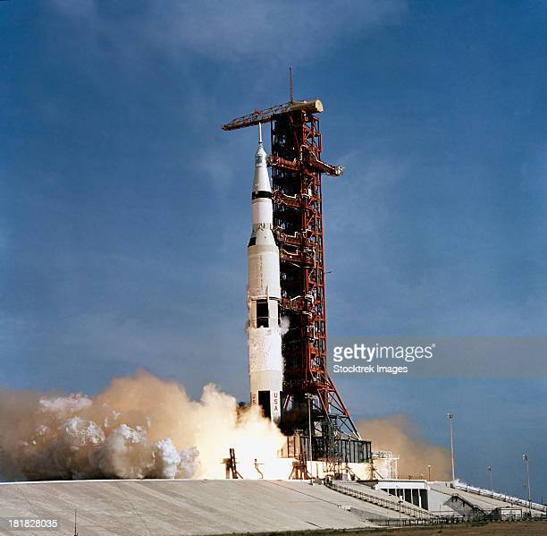 Apollo 11 space vehicle taking off from Kennedy Space Center.