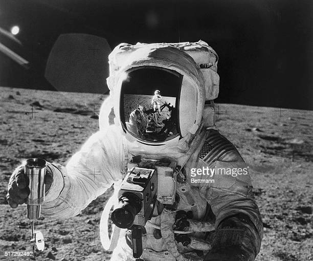 Apollo 12 astronaut Alan Bean's face mask reflects the Apollo 12 astronaut Commander Charles 'Pete' Conrad as Conrad snaps his companion's photo...