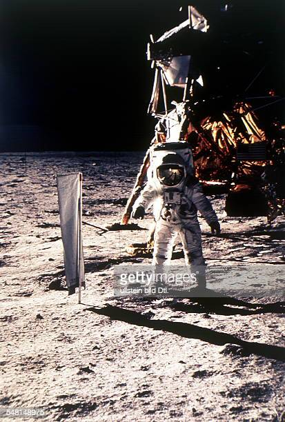 Apollo 12 Mission / lunar landing Astronaut Alan Bean has set up the Solar Wind Composition Experiment on the Moon behind him the lunar module...