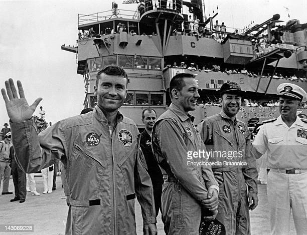 Apollo 13 Astronauts Apollo 13 Astronauts Fred W Haise Jr John L Swigert Jr And James A Lovell Jr Stand On Board The Uss Iwo Jima With Rear Admiral...