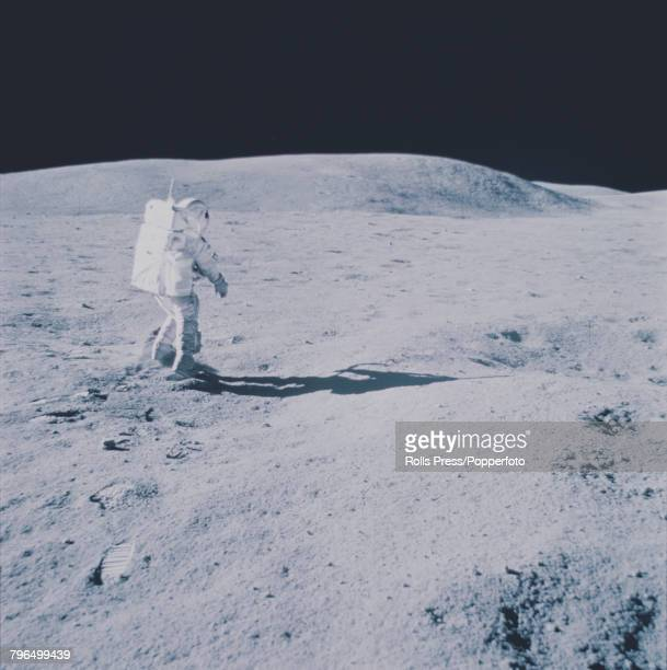 Apollo 16 Lunar Module pilot Charles Duke is pictured wearing his space suit on the lunar surface of the Moon as Commander John Young takes the...