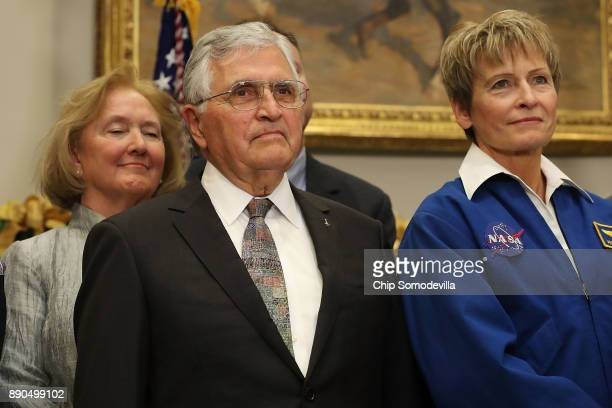 Apollo 17 astronaut Jack Schmitt his wife Teresa Fitzgibbon and NASA astronaut Peggy Whitson attend the signing ceremony for 'Space Policy Directive...
