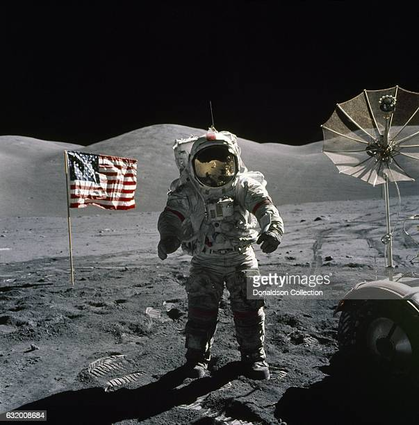 Apollo 17 commander Eugene A Cernan stands by the American flag during his second space walk becoming the last man to walk on the Moon on December 12...