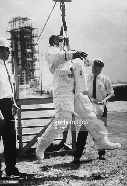Apollo 7 astronaut Walter Shirra trying out the emergency escape system
