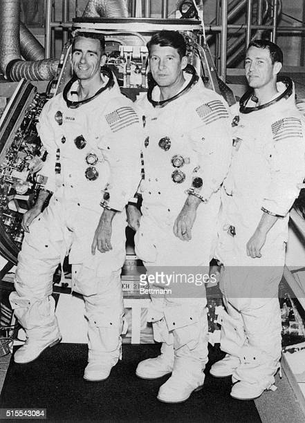 Apollo 7 astronauts Walter Cunningham command module pilot Walter MSchirra Jr commander and Donn Eisele lunar module pilot pause outside their...
