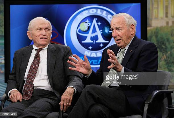 Apollo 8 crew members James Lovell speaks as Frank Borman looks on during a live taping of a NASA TV program at the Newseum November 13 2008 in...