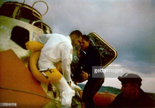 Apollo 8 Lunar Module Pilot William Anders is helped from the bobbing Apollo 8 spacecraft during the early morning hours 27 December 1968 The Apollo...