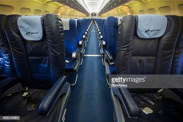 Apollo business class seating stands in front of standard seats in the empty cabin of a Cyprus Airways Public Ltd operated Airbus A320 aircraft...