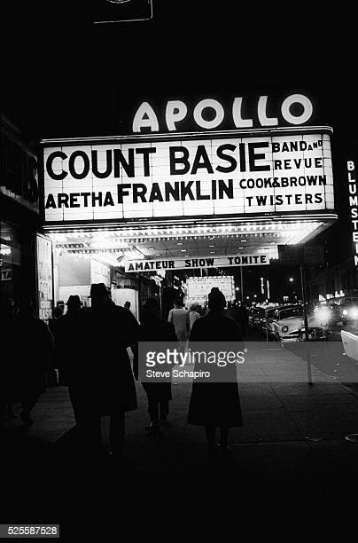 Apollo Theater marquee with Count Basie Band and Revue singer Aretha Franklin Cook Brown and the Twisters listed on the sign New York 1962