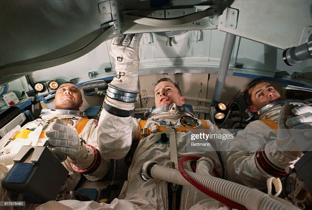 Roger Chaffee with Edward White and Virgil Grissom in Space Capsule : News Photo