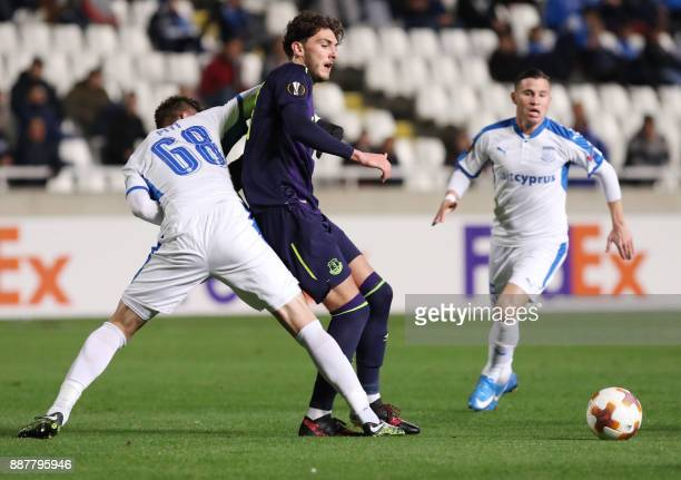 Apollon Limassol's Andrei Sardinero fights for the ball against Everton's Fraser Hornby during the UEFA Europa League group stage football match...