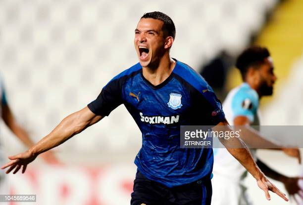 Apollon Limassol's Argentine forward Emilio Zelaya celebrates after scoring an equaliser during the UEFA Europa League group H football match between...