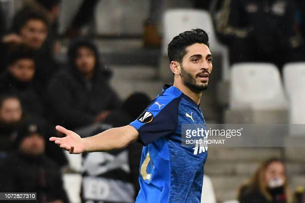 Apollon Limassol's Cyprus defender Marios Stylianou reacts after scoring the third goal during the UEFA Europa League Group H football match between...