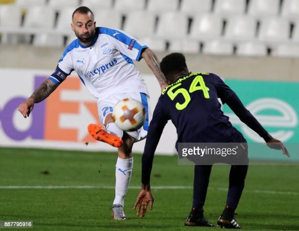 Apollon Limassol's Fotis Papoulis kick the ball as Everton's Beni Baningime defends during the UEFA Europa League group stage football match between...