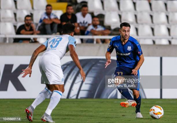 Apollon Limassol's Spanish forward Adrian Sardinero passes the ball as he is marked by Marseille's French defender Jordan Amavi during the UEFA...