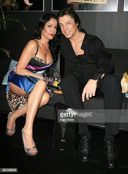 Apollonia Kotero and Emmanuel Delcour pose at the Judith Ripka booth during MercedesBenz Fashion Week held at Smashbox Studios on March 13 2008 in...