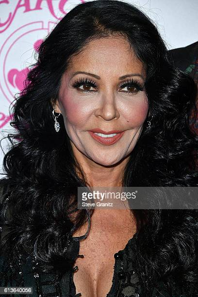 Apollonia Kotero arrives at the 2016 Carousel Of Hope Ball at The Beverly Hilton Hotel on October 8 2016 in Beverly Hills California