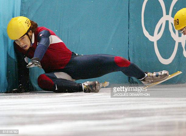 Apolo Anton Ohno and Canadian Mathieu Turcotte crush into the bareer during the men's 1000m final short track race at the Olympic Ice Center 16...