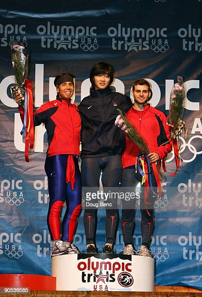 Apolo Anton Ohno in second place Simon Cho in first place and Jeffrey Simon in third place stand on the podium after the Men's 500 Final at the US...
