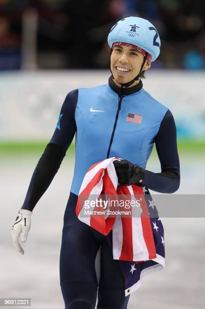 Apolo Anton Ohno of the United States celebrates after winning bronze during the Short Track Speed Skating Men's 1000m Final on day 9 of the...