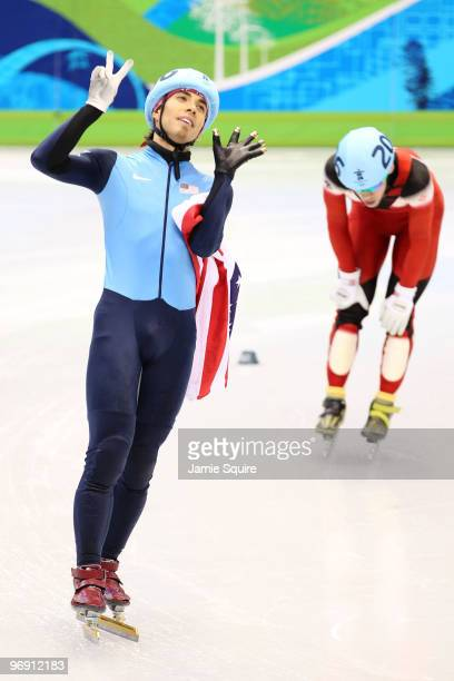 Apolo Anton Ohno of the United States holds up seven fingers to signify his seven Olympic medals after winning bronze during the Short Track Speed...