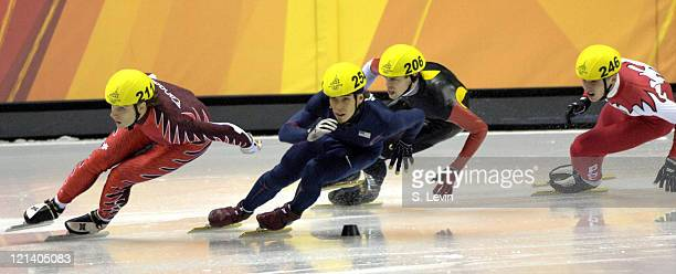 Apolo Anton Ohno of the United States in action during the Short Track Speed Skating 500 m at the 2006 Olympic Games held at the Palavela in Torino...
