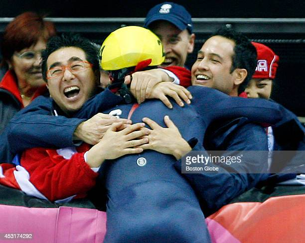 Apolo Anton Ohno of the United States is mobbed by teammates after he won the gold medal in the men's 500meter short track speed skating finals